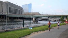 People involved in sports on the embankment of the river Schuylkill Stock Footage