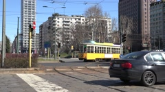 4K Old tram intersection road Milan traffic street car pass crossroad people day Stock Footage
