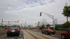 Cars waits the enable signal of a traffic light at an intersection Stock Footage