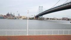 Philadelphia skyline and Benjamin Franklin Bridge over Delaware River Stock Footage