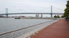Benjamin Franklin Bridge and the Delaware river embankment. Stock Footage