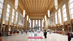 People walks in the spacious hall of 30th Street Station. Stock Footage