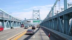 Cars moves at Benjamin Franklin Bridge at sunny day. Stock Footage