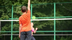 Boy playing badminton with his mother on the playground, rear view Stock Footage