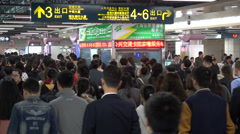 China public transport, business people exit busy subway station in Shanghai - stock footage