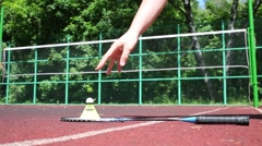 Male hand raises and lowers shuttlecock from the racket Stock Footage
