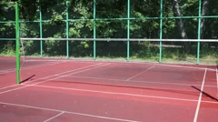 Fenced outdoor area with two nets for a game of badminton Stock Footage