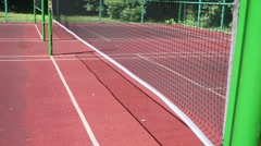 Net for badminton in the open sports court on a sunny day Stock Footage