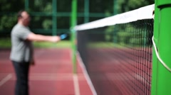 Net at an open sports court. Nearby out of focus stands a man Stock Footage