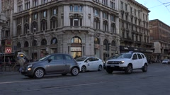 4K Traffic street busy intersection tramway pass car drive Milan downtown road  Stock Footage