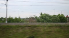 Cars moving on the road running parallel to the railroad - stock footage