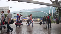Passengers with luggage in front of the airport Domodedovo. Stock Footage