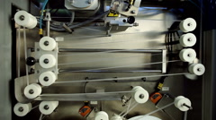 Factory for production of dairy products. Detail of modern packaging equipment. - stock footage