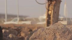 Hydraulic hammer breaker on excavator destroying rocks Stock Footage