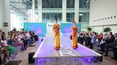 Two girls show uniform of stewardesses of Air India at DME Runway Stock Footage
