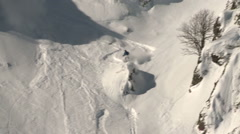 the skier goes down on a mountain slope - stock footage