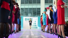 Models in the uniforms of various airlines go to the podium Stock Footage