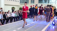 Models in the uniforms of various airlines leaves the podium Stock Footage