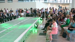 Spectators and journalists after fashion show DME Runway Stock Footage