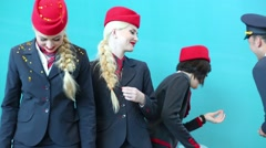 Group of happy people in uniform of VIM Avia airline at the fashion show Stock Footage