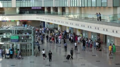 Many people walk along a spacious hall of the Domodedovo airport. Stock Footage