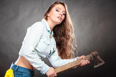 Sexy strong woman feminist with axe working. Stock Photos