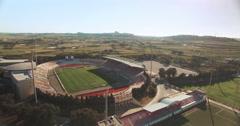 A High Aerial shot over a European Football Stadium Stock Footage