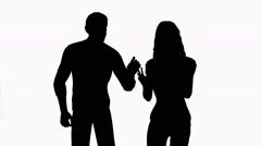 Man and woman arguing on white background medium shot Stock Footage