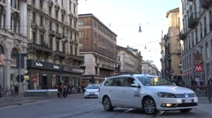 4K Car transportation busy road crowded downtown Milan people commute journey - stock footage