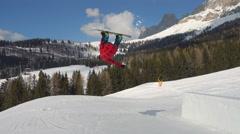 Snowboarder doing backflip on kicker Stock Footage