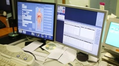 Two monitors in the hospital room with computed tomography results Stock Footage
