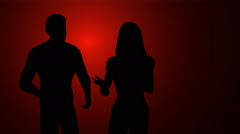 Couple arguing on red background Stock Footage