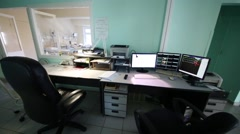 Desk of doctor with monitors showing vital signs of patients Stock Footage