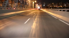 View of a metal bridge at night from moving vehicle Stock Footage