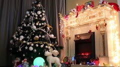 Christmas tree and toys in the interior with a fireplace Stock Footage