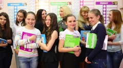Seven girls and three women standing with textbooks in the hands Stock Footage