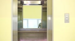 Parents with daughter enter the elevator in a residential building Stock Footage