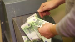 Man throws hundred euro bills in the trash one by one Stock Footage