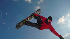 Snowboarder jumping back flip slow motion Stock Footage