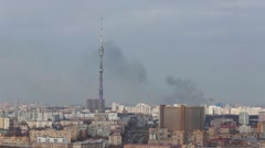 Black smoke from the fire in the sky near Ostankino Telecom Tower Stock Footage