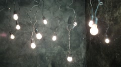 Dark room with swinging lamps hanging from the ceiling Stock Footage