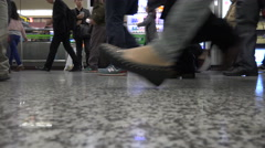 Feet and legs of commuting subway passengers at station Shanghai, China Stock Footage