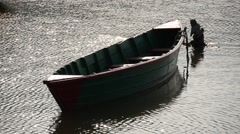 Lone moored boat in the sun - stock footage