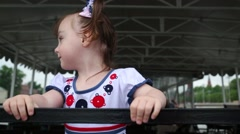 Smiling little girl holds at the railing on the excursion boat Stock Footage