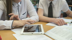 Two girls play in game using a electronic tablet Stock Footage