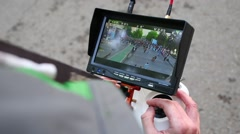 The man controls quadcopter with the camera using the screen Stock Footage