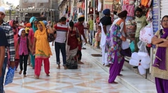 Indian people in the gift shop next to the Golden Temple in Amritsar. India Stock Footage