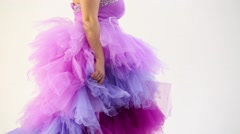 Woman in the lush purple dress goes from side to side Stock Footage