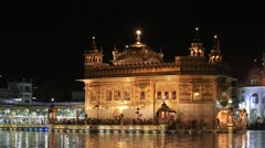 Indian people visiting the Golden Temple in Amritsar at night , India Stock Footage