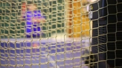 Bounding net behind automatic serving system balls at table tennis Stock Footage